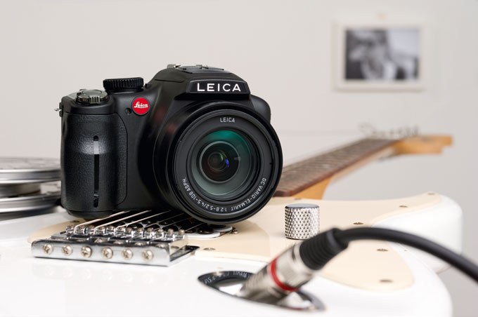 Leica V-Lux 3 dslr camera with guitar photo