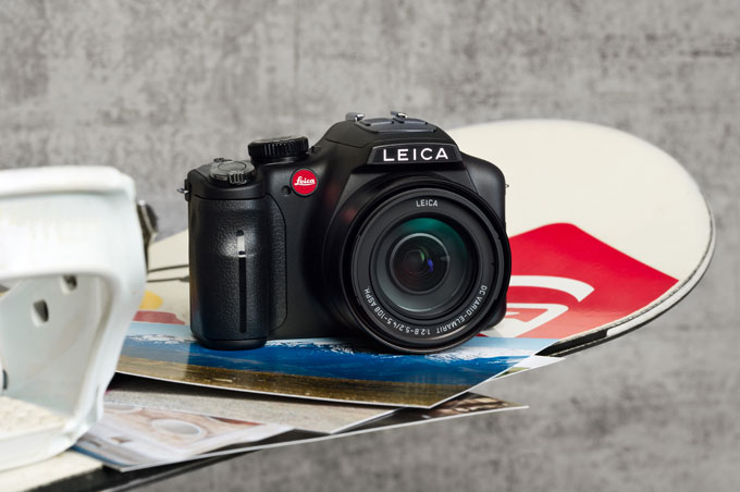 Leica V-Lux-3 DSLR camera on snowboard photo
