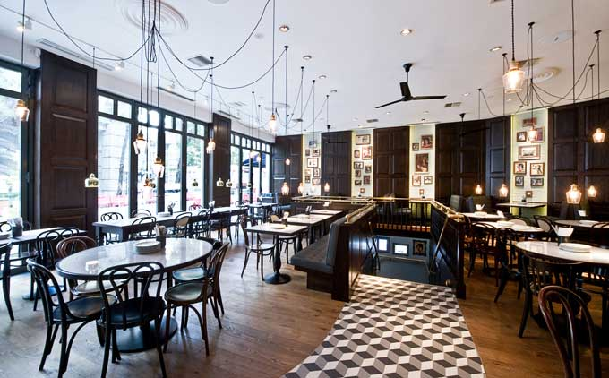 interior shot of elegant ground gloor of Dishoom restaurant with black and white marble floor