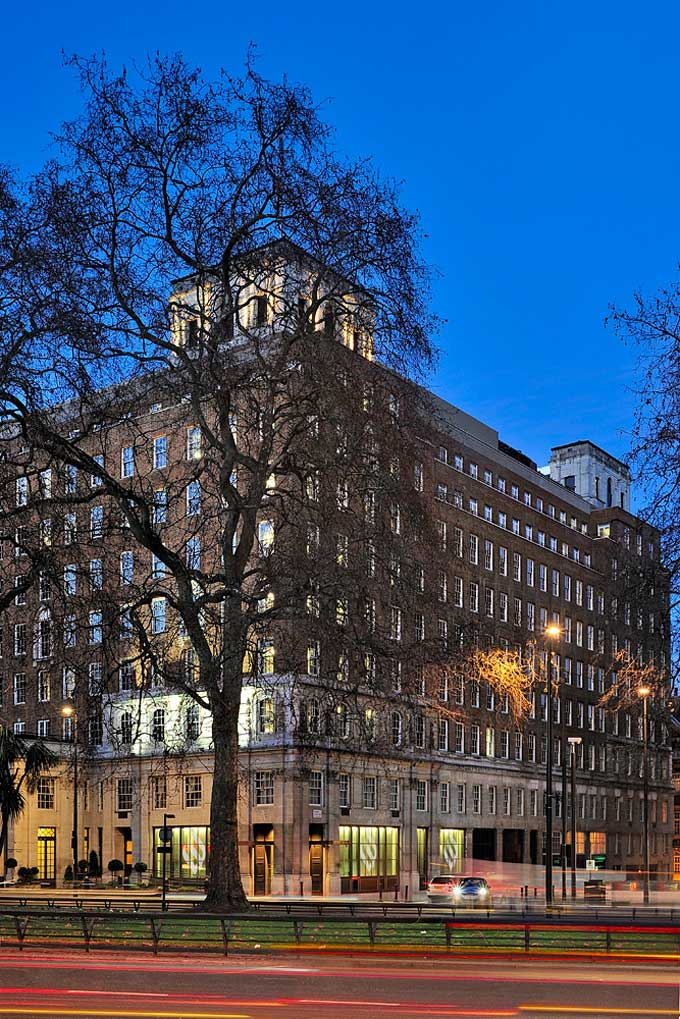 exterior photo of Grosvenor House Apartments on Park Lane in evening