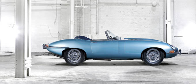 blue E-Type Convertible 1968 in white-walled warehouse