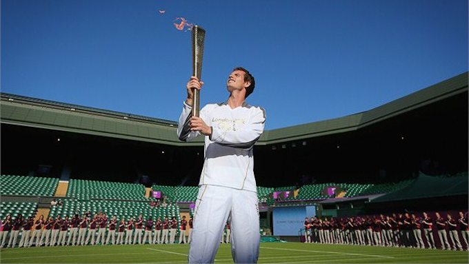 Andy Murray holds up the Olympic torch