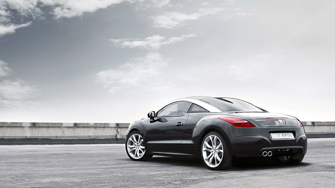 image of the backside view of a black Peugeot RCZ