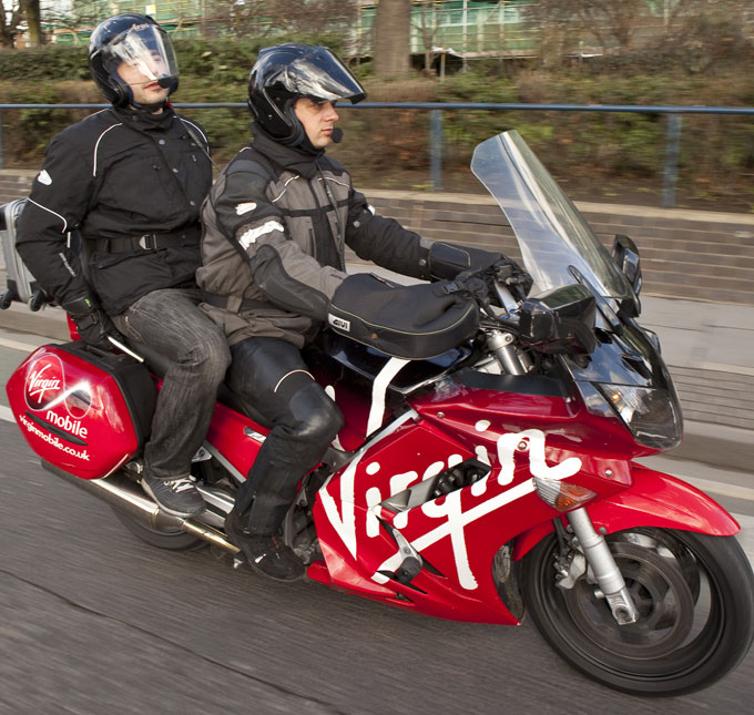Virgin Limo Bike motorbike in transit carrying the passenger