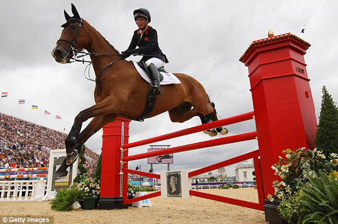 Zara Phillips jumps her horse at Olympics events