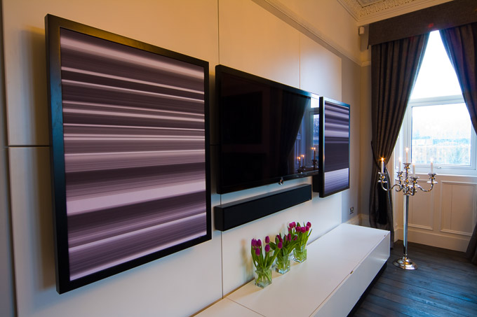 Wall mounted TV and flat panel speakers in Finite Solutions Show Home ground floor lounge