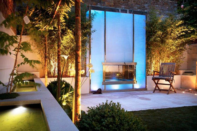 inside lit blue fireplace in a garden by award winning garden designer Kate Gould