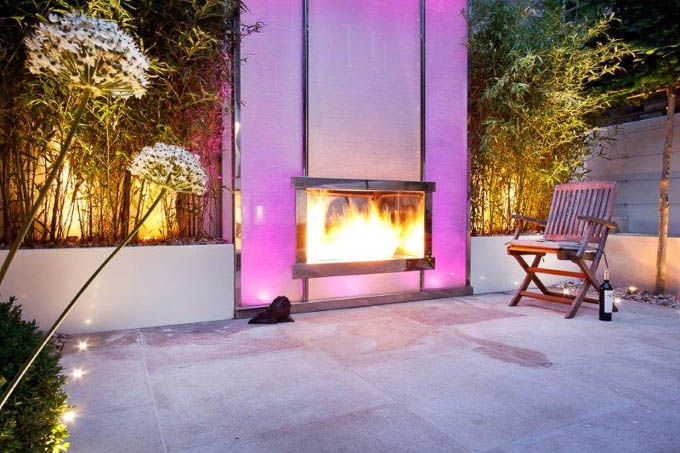 inside pink green fireplace in a garden by award winning garden designer Kate Gould