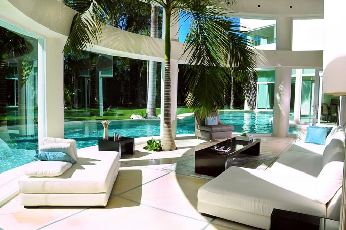 modern interior image of Aqua Villa, Playa del Carmen, Mexico looking out at open air swimming pool