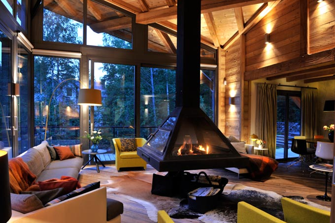 interior view of warm fireplace in modern Alpine Chalet