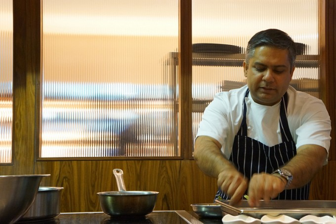 Cinnamon Kitchen Executive Chef, Vivek Singh, prepares a dish for his 'Curry for Change' menu.